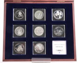 A SYMBOLS OF CANADA SILVER DOLLAR EIGHT COIN SET, boxed with COA