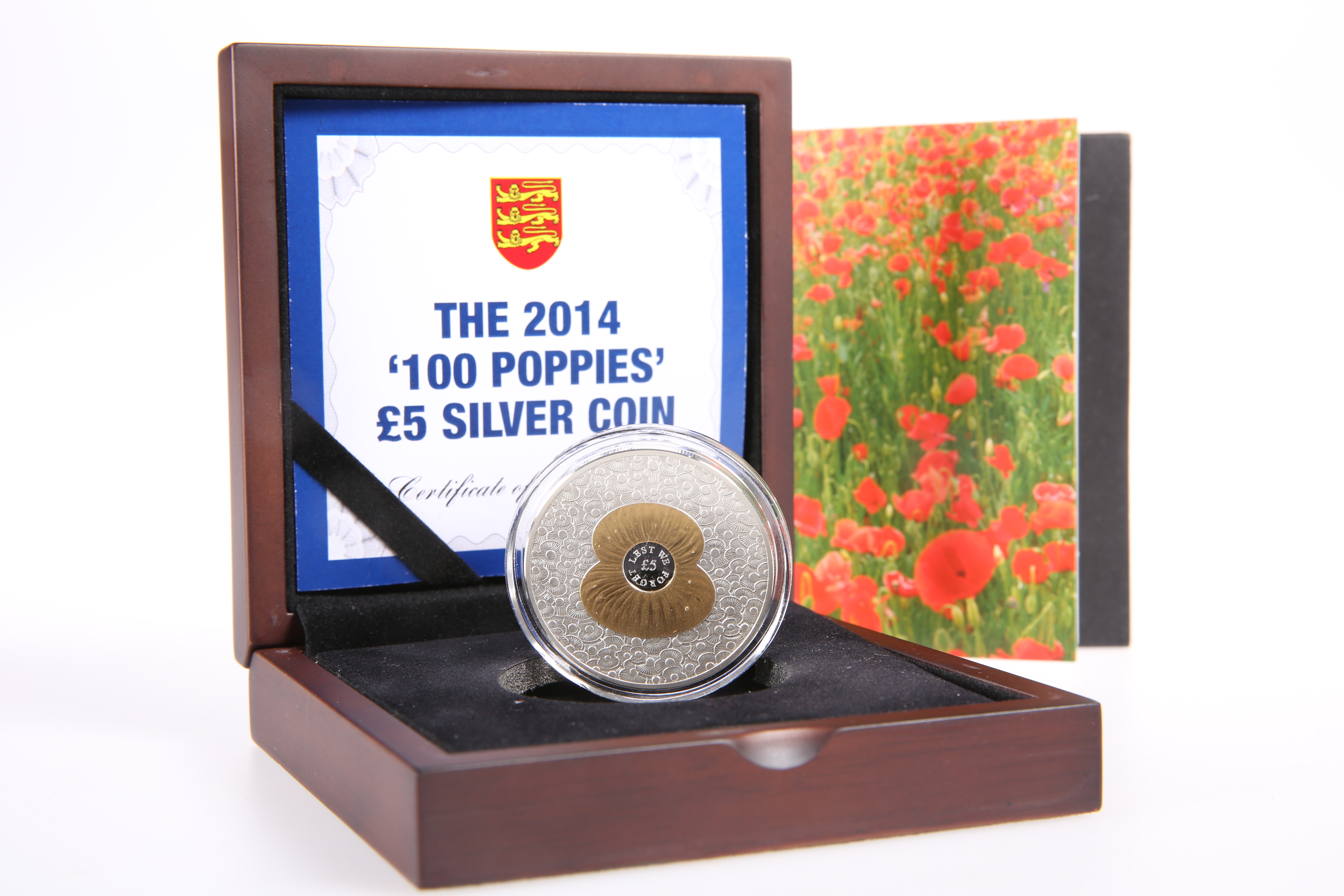 A 2014 '100 POPPIES' £5 SILVER COIN, boxed with COA