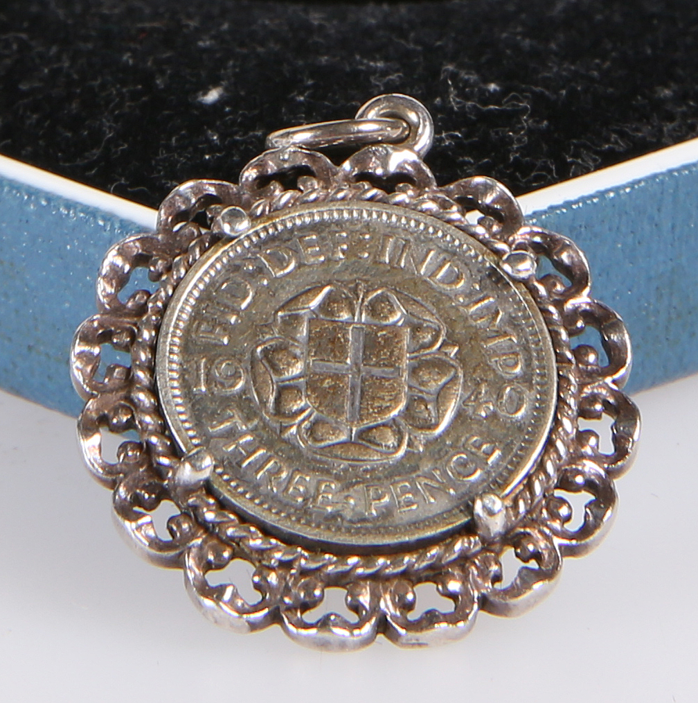 A GEORGE VI SILVER THREE-PENCE BIT, in pendant mount