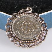 A GEORGE VI SILVER THREE-PENCE BIT, in pendant mount