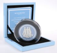 "A COMMONWEALTH MINT SPECIAL EDITION COIN, ""THE WORLD'S FIRST WEDGWOOD JASPERWARE FIVE POUND COIN,"