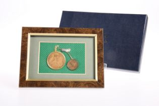 A FRAMED ART WORK DEPICTING A PENNY-FARTHING AND INCORPORATING 1938 ONE PENNY AND A 1939 FARTHING,