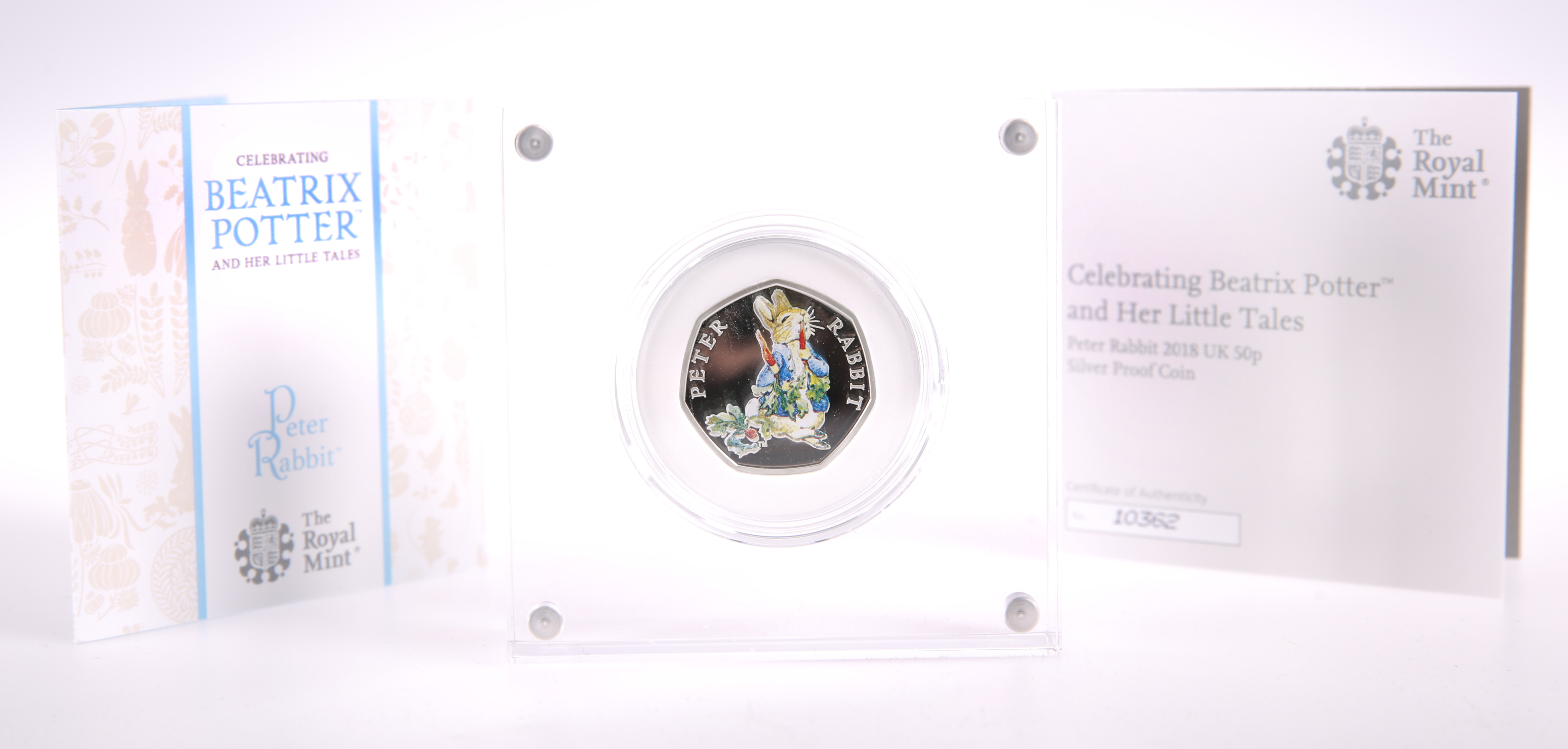 A ROYAL MINT PETER RABBIT 2018 50P SILVER PROOF COIN, boxed with COA no. 10362