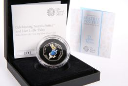 A ROYAL MINT BEATRIX POTTER PETER RABBIT 50P SILVER PROOF COIN, boxed with COA