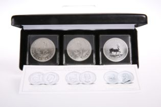 """A SET OF THREE """"KRUGERRAND"""" SILVER COINS, boxed with papers"""