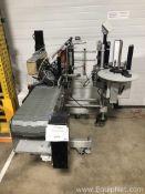 Quadrel O65 Side Panel Labeling System with Side Drive Hugger Belt System 2013