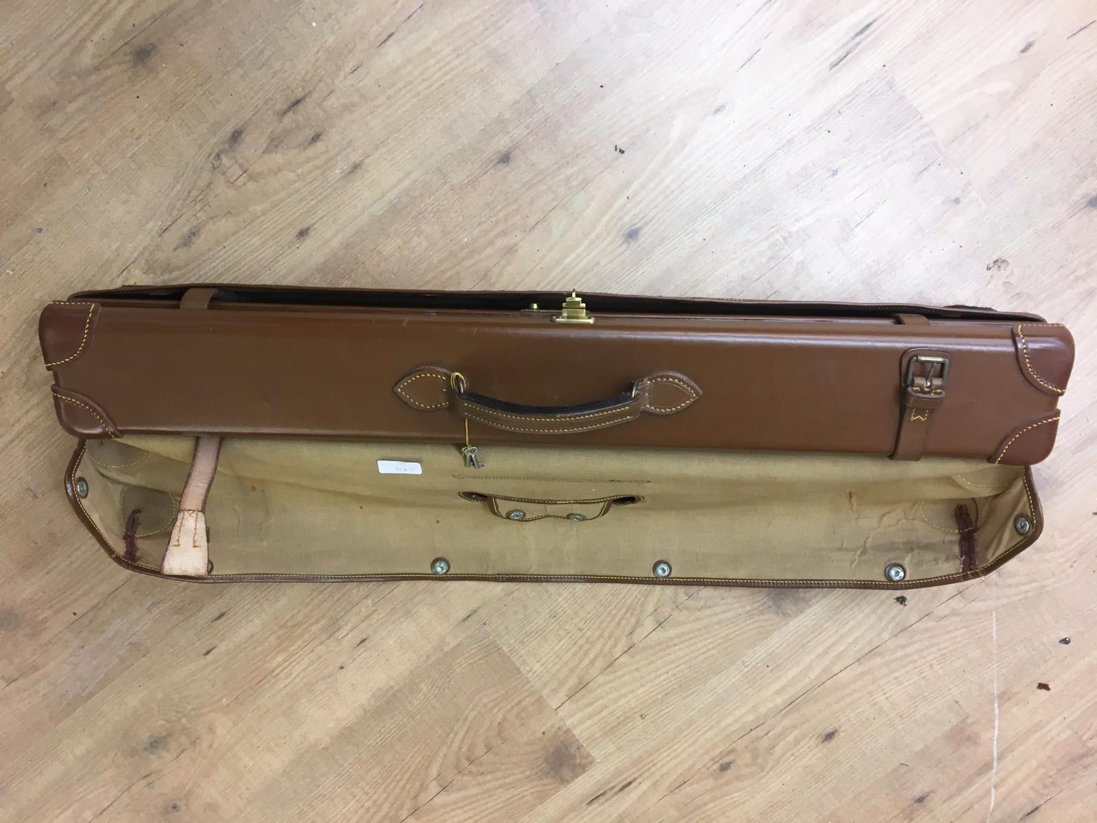 Lot 10 - Best English quality leather shotgun case with James Purdey and sons label,in outer cover, will taje