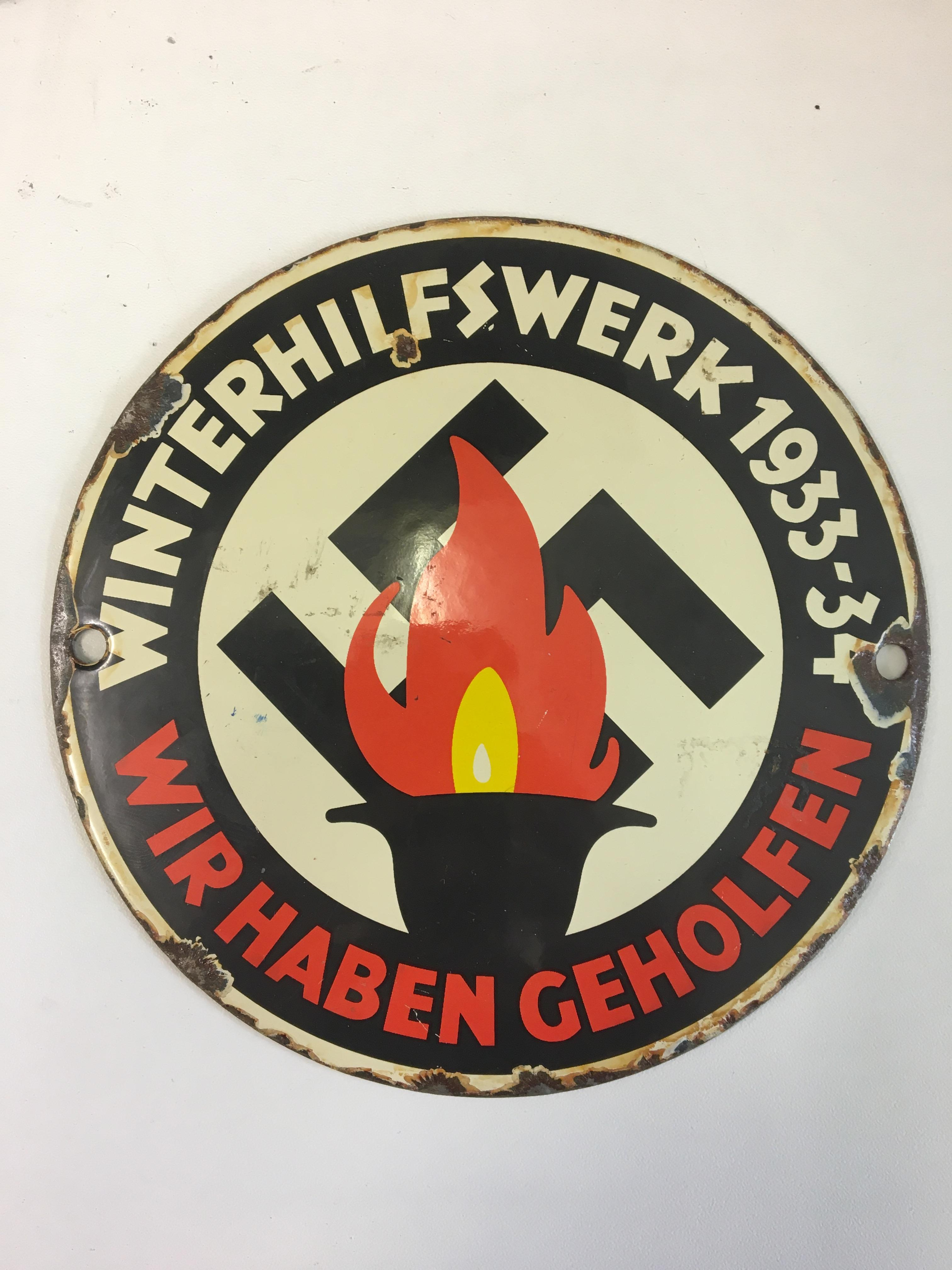 "Lot 19 - Pre WWII German enamelled sign ""1933-34 Winterhilfswerke"" plaque."