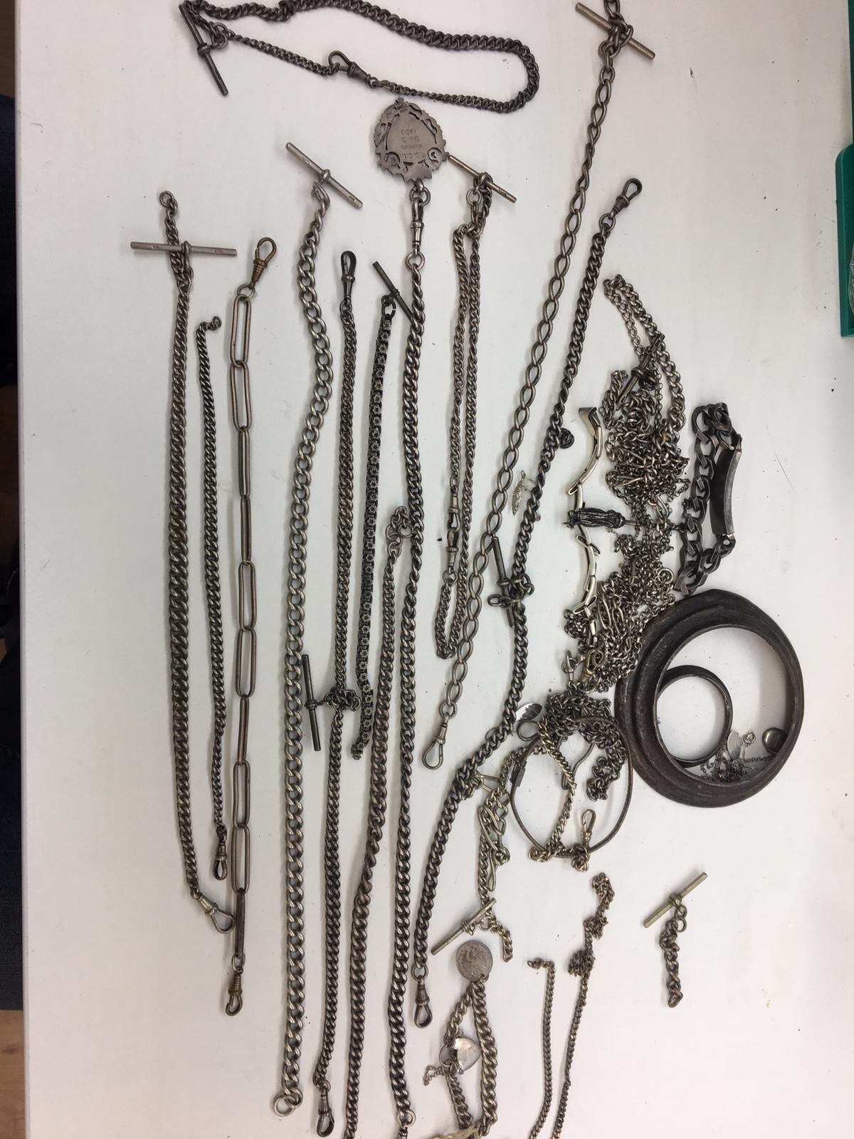 Lot 16 - Large qty of silver Albert chains and bracelets, total weight 650 grams.