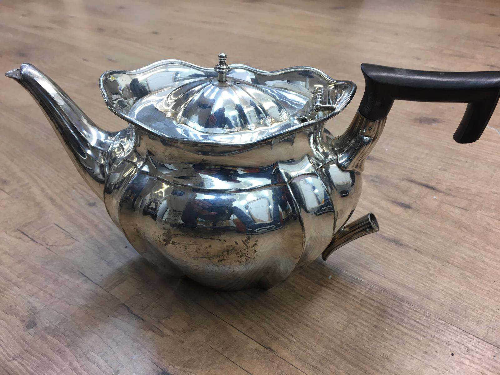 Lot 17 - HM Silver teapot, Sheffield, 1907, William Hutton & Sons, damage to the handle, weight 705g.