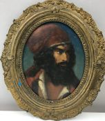 19th c Hungarian oil of Bearded man in red hat, in gilt oval frame.