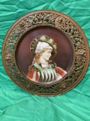 19th C Continental painted ceramic plaque portrait of woman in ornate filigree metal surround.