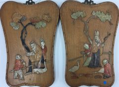 Pair of Shibyama inlaid plaques.