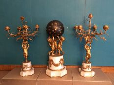 19th C Clock garniture, with bronze ball dial being held by three gilded putti on a garlanded marble