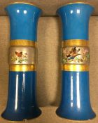 Pair of blue ground Vases with gilded middles bearing bird and butterfly decoration.