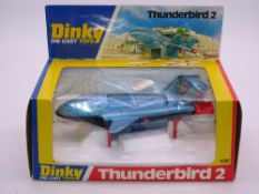 A DINKY 106 THUNDERBIRD 2 - Metallic Blue with black base and red legs version - E - Appears