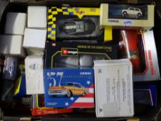 A tray of assorted diecast cars and other vehicles by BBURAGO, MAISTO, CORGI etc - VG in F/VG