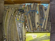 HO Gauge: A tray of vintage MARKLIN 3-rail track including electric points, straights, curves