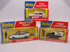 A group of DINKY Police vehicles: A 254 RANGE ROVER, a 264 ROVER 3500, and a 277 LAND ROVER - E -