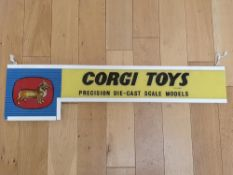 A CORGI Toys glass shop display sign - circa 1960s - mounted in a frame (A/F - Break to glass (
