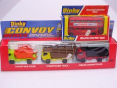 A pair of DINKY toys comprising: A 289 ROUTEMASTER Bus and a 399 CONVOY Gift Set - E - Appear unused