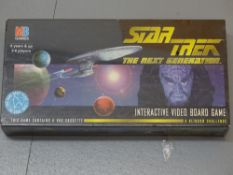 An MB games STAR TREK THE NEXT GENERATION interactive video board game - factory sealed - E in VG/