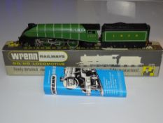 OO Gauge Model Railways: A WRENN W2209 Class A4 steam locomotive in LNER green livery 'Golden Eagle'