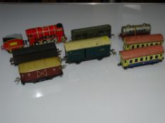 O Gauge Model Railways: A quantity of mixed rolling stock by various manufacturers to include some