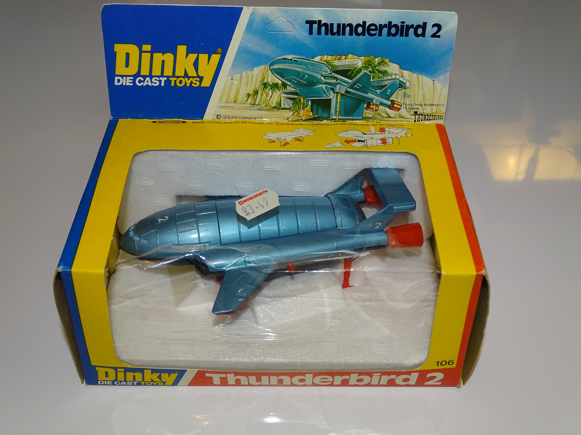 Lot 31 - A DINKY 106 THUNDERBIRD 2 - Metallic Blue with black base and red legs version - E - Appears