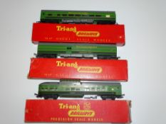 OO Gauge Model Railways: A group of TRI-ANG Transcontinental coaches in the rarer 2 tone green