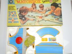 A MATCHBOX SWITCH-A-TRACK Roadway Set - appears almost complete but cars are missing - G in F/G box
