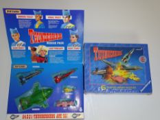 A MATCHBOX THUNDERBIRDS Rescue Vehicle Pack - together with a RAVENSBURGER THUNDERBIRDS themed