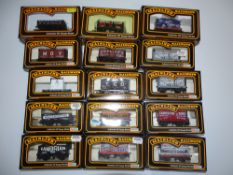 OO Gauge Model Railways: A group of various MAINLINE wagons as lotted - VG in G/VG boxes (15)