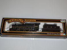 OO Gauge Model Railways: A MAINLINE Jubilee Class steam locomotive in LMS black livery 'Neptune' -