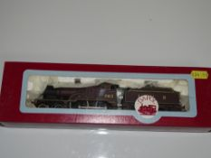 OO Gauge Model Railways: A DAPOL D17 Class 2P steam locomotive in LMS maroon livery numbered 563 -