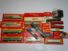 OO Gauge Model Railways: A large quantity of assorted TRI-ANG rolling stock and accessories as