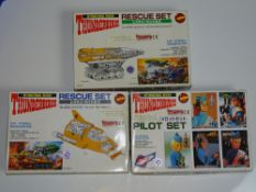 A group of vintage plastic model kits by IMAI comprising: THUNDERBIRDS 4, THE MOLE and PILOT SET -