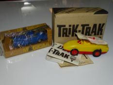 A WRENN MAGICAR and a TRIK-TRAK stunt car (both manufactured by SPOT-ON) VG-E in F/VG boxes (2)
