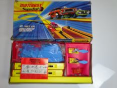 A MATCHBOX SUPERFAST Track 600 Double Booster Racing Circuit Set - appears complete and unused