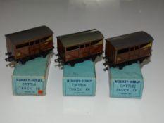 OO Gauge Model Railways: A group of HORNBY DUBLO early post war 3-rail LMS cattle trucks - G in G