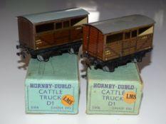 OO Gauge Model Railways: A pair of HORNBY DUBLO early post war 3-rail LMS cattle trucks - G in G