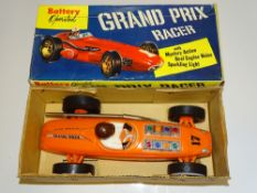 A battery operated GRAND PRIX racer car - maker unknown - VG in G box