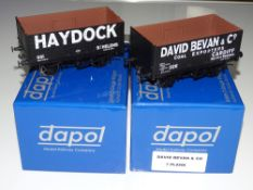 O Gauge Model Railways: A pair of modern DAPOL 7-plank private owner open wagons to include: '