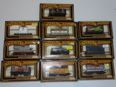 OO Gauge Model Railways: A group of MAINLINE wagons as lotted - VG/E in G/VG boxes (10)