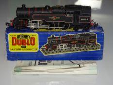 OO Gauge Model Railways: A HORNBY DUBLO 3218 3-rail 2-6-4 Steam tank locomotive in BR black livery