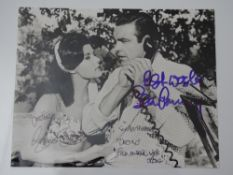 JAMES BOND: AUTOGRAPHS: A signed black and white photograph/movie still: SEAN CONNERY and EUNICE