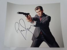 AUTOGRAPHS: JAMES BOND: PIERCE BROSNAN - signed action photo - has been independently verified and
