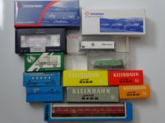 HO GAUGE MODEL RAILWAYS: A group of European Outline wagons and coaches by MARKLIN, KLEINBAHN and