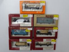 HOm GAUGE MODEL RAILWAYS: A group of BEMO HOm mixed wagons, all fitted with Kaydee couplings in