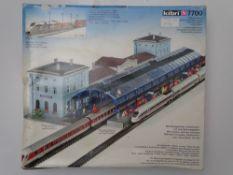 N GAUGE MODEL RAILWAYS: A KIBRI 7700 station and twin canopy kit, unbuilt - as new internally -